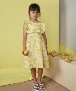2. Lemon and banana ruffle bib dress from Milk & Biscuits.